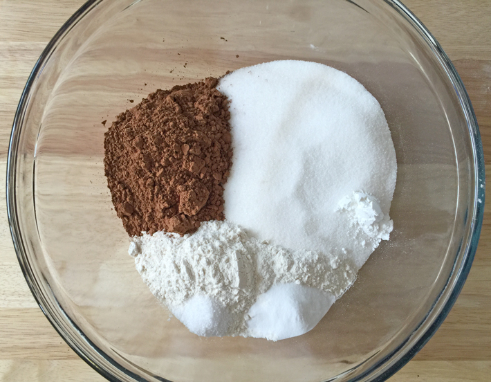 mixing dry ingredients into the cake