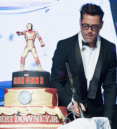 Robert Downey Junior cutting his 48th Birthday Cake