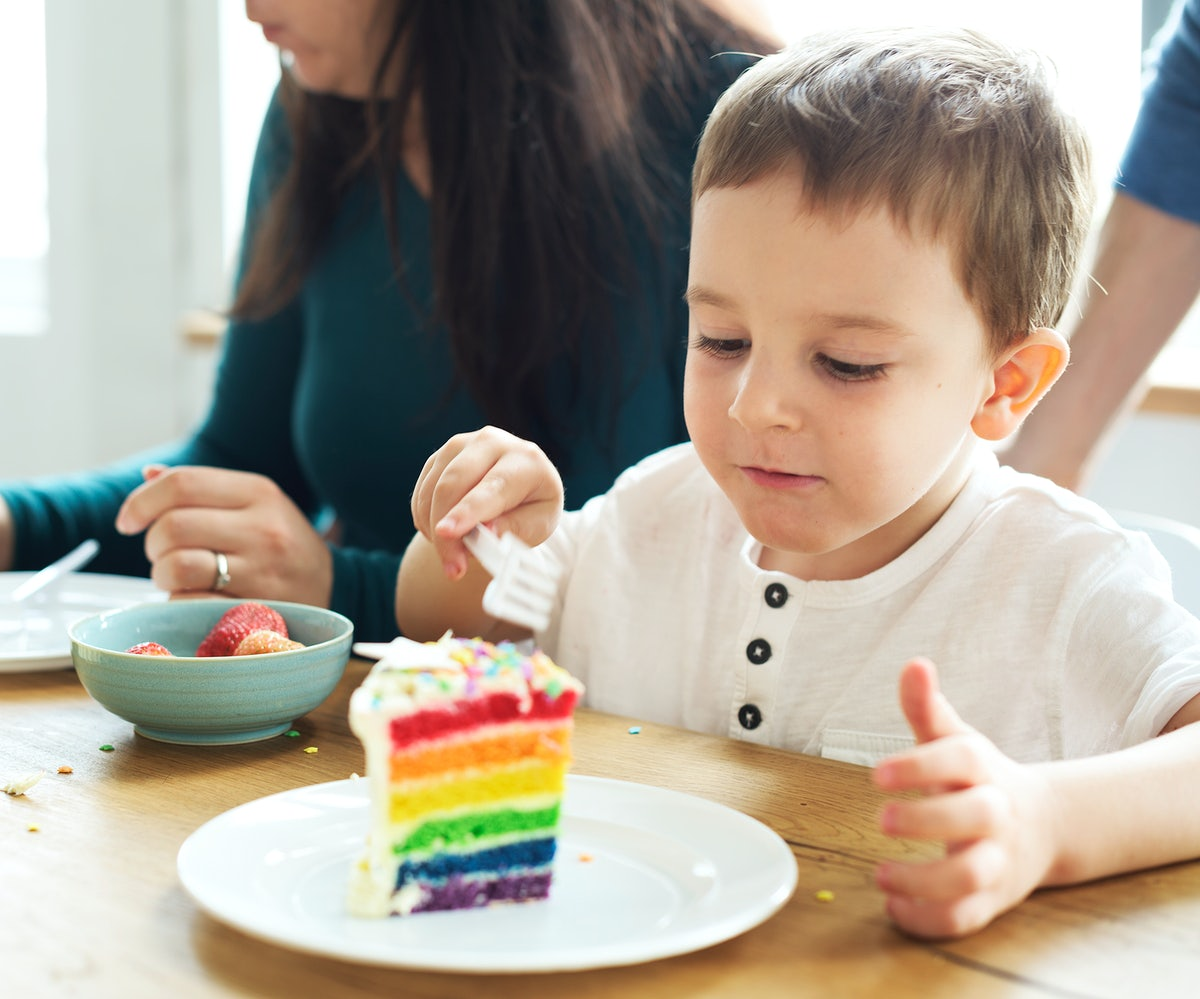 a kid while eating cake